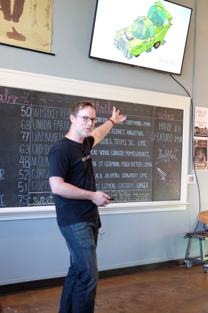 Photo of Ben Strackany, CEO of DevelopmentNow, during his presentation at Camp Optimization