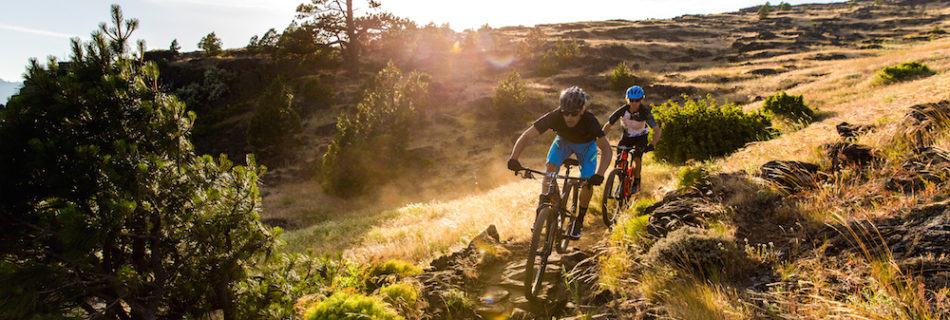 Specialized bikers riding on rough terrain
