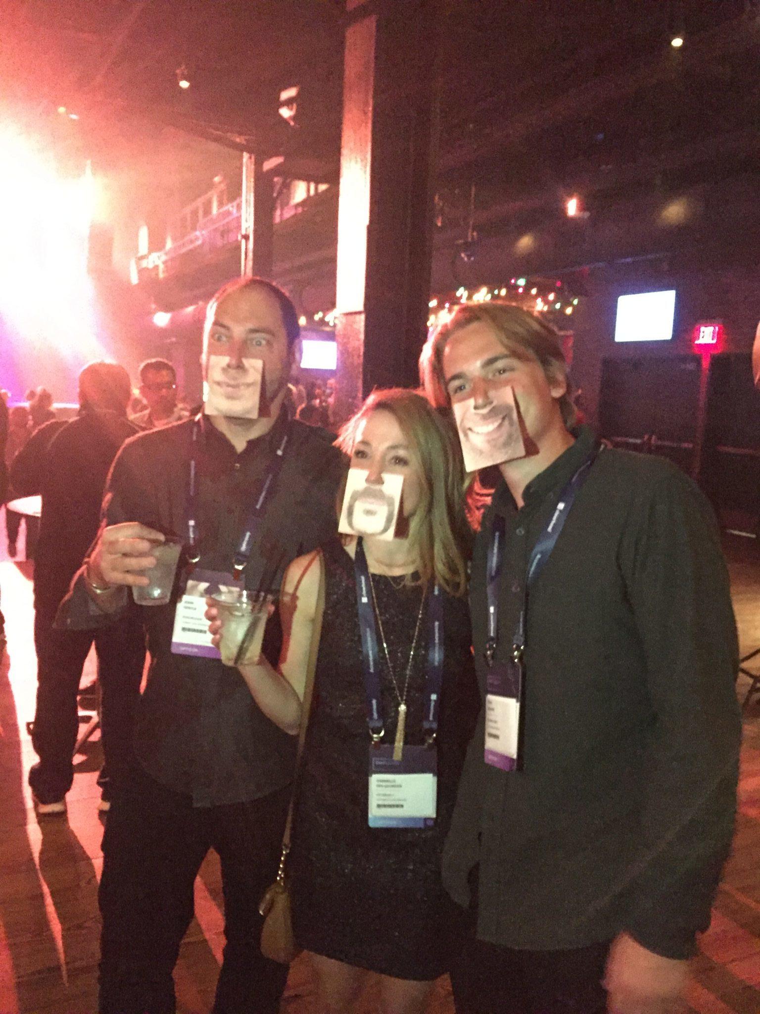 Opticon 2017 - Three people wearing face coasters
