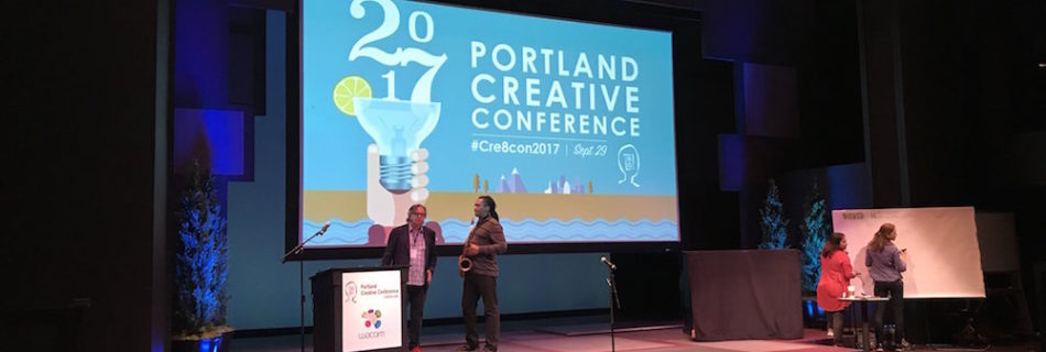Portland Creative Conference - Speaker in front of audience